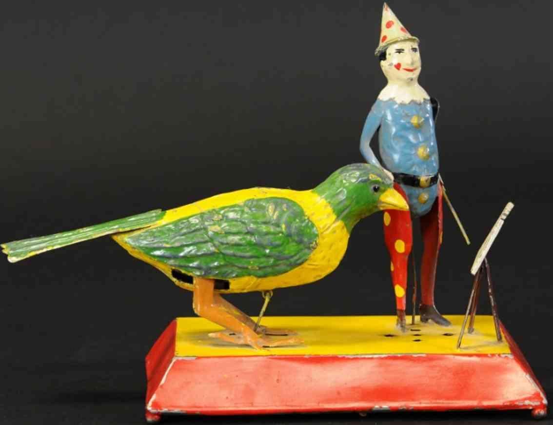 tin toy clown teaching bird a song