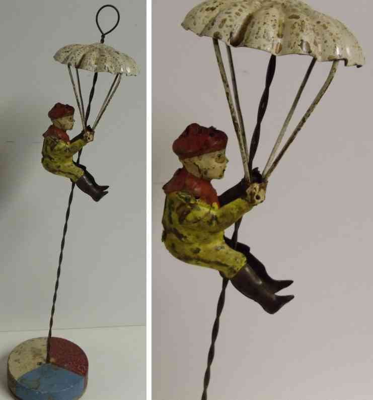 tin toy tin figure and parachute gunthermann