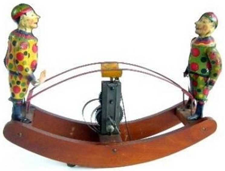 See-Saw friction tin toy with 2 clowns