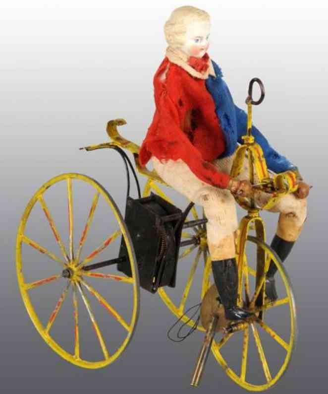 Bisque head doll on velocipede wind-up toy