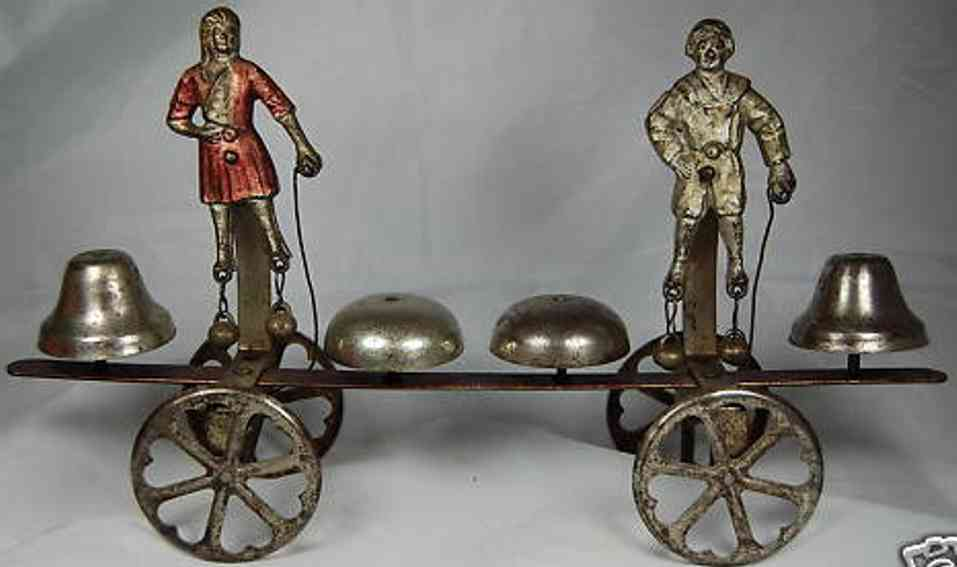 watrous mfg co tin cast iron boy and girl dancing bell toy