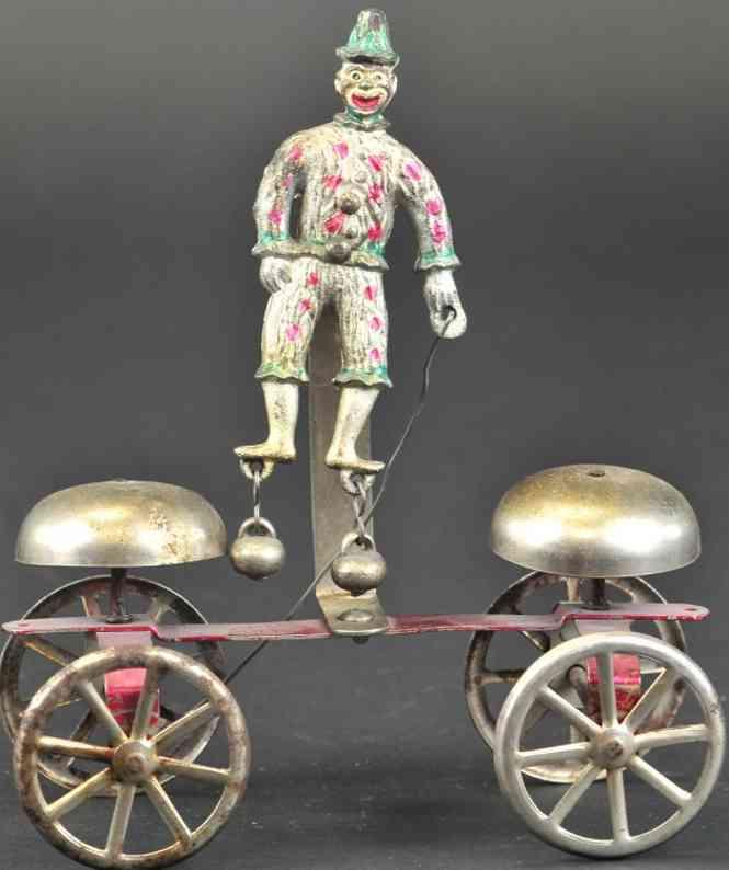 watrous mfg co gusseisen clown als glockenspielzeug  zwei glocken