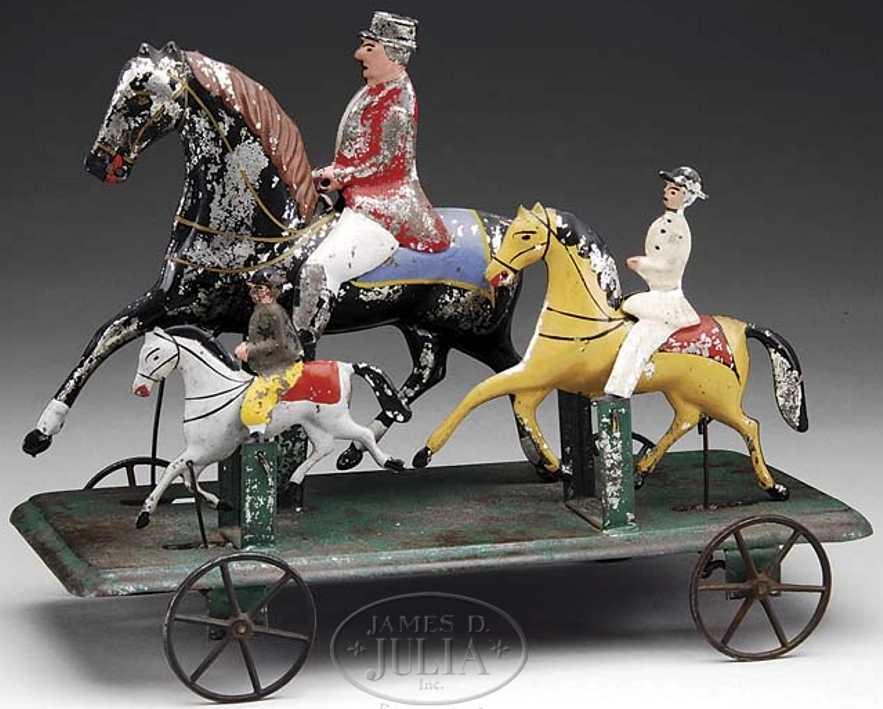 Althof Bergmann Drei Reiter mit Pferden auf Plattform mit Rädern
