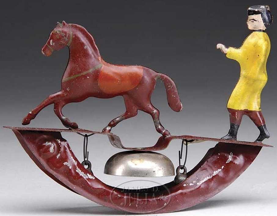 Fallows Pferd mit Trainer als Glockenspielzeug