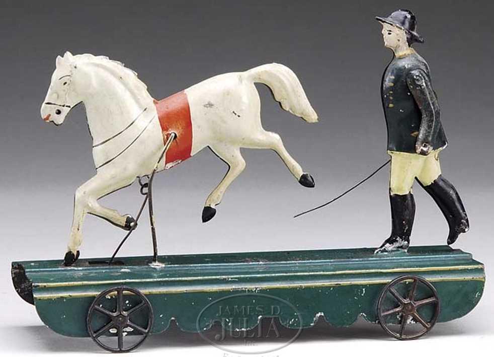 Fallows Pferd mit Trainer