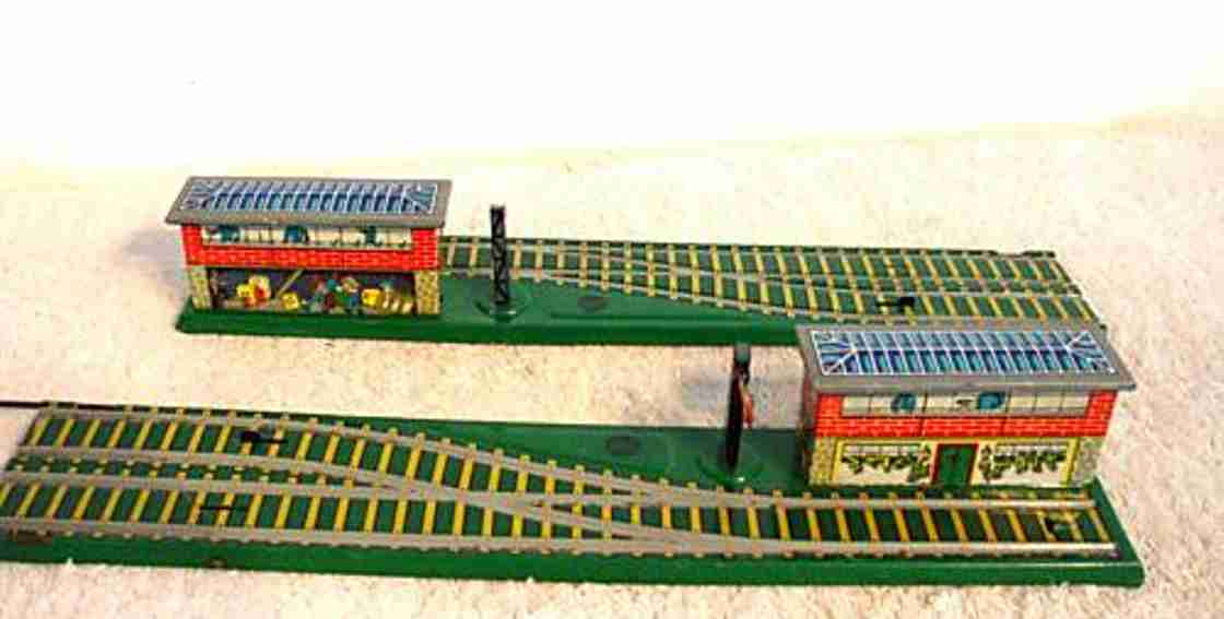 gescha 80/2 tin toy turn railway with clockwork in green, brown and blackly lith