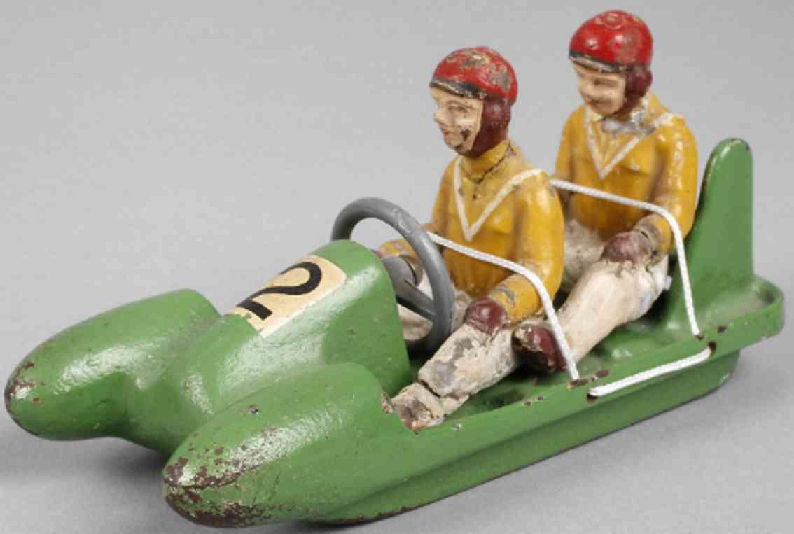 heusser karl cast iron toy hela-bob two-man bob green