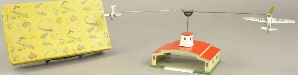 paya tin toy hangar with two airplanes