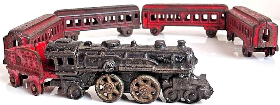 kilgore lokomotive tender vier personenwagen spielzeug gusseisen bodenlaeufer