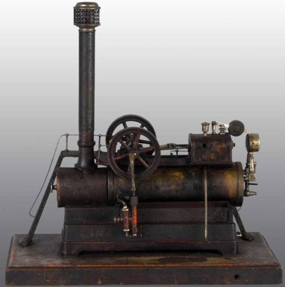 carette 691 horizontal steam toy overtype steam engine. it has a steam gauge, weighted safety