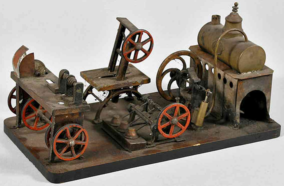 plank ernst steam toy factory horizontal steam engine on wood board with hammer work, band