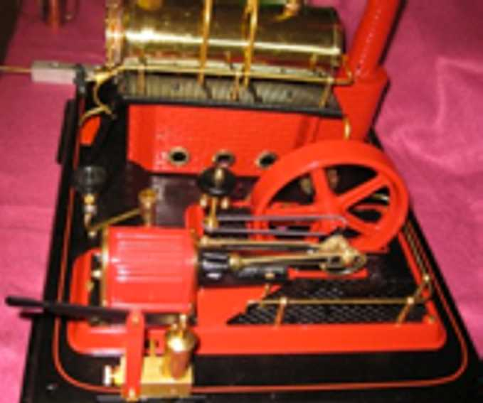 wilesco D21 horizontal steam toy typical wilesco layout. boiler to the left and agreggate to