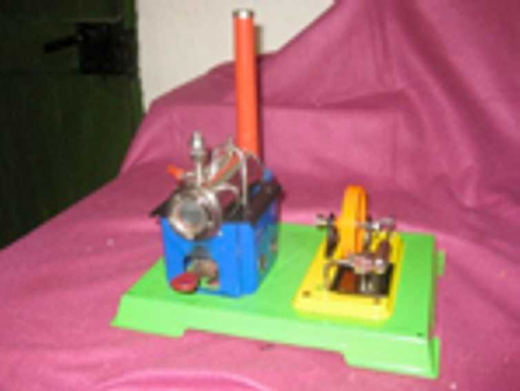wilesco D8 horizontal steam toy typical wilesco layout. boiler to the left and agreggate to