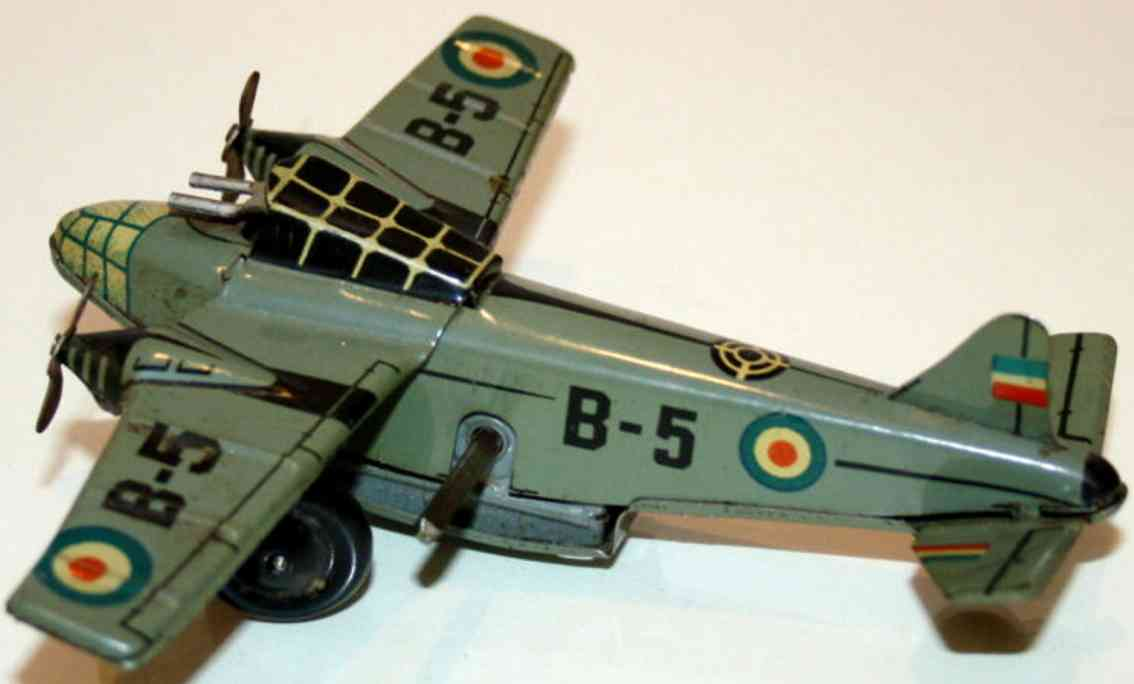 arnold 750 tin toy airplane bomber b-5 clockwork