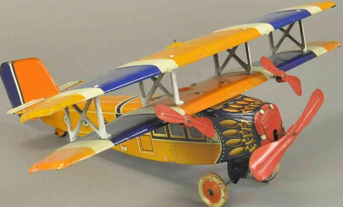 distler blech spielzeug flugzeug doppeldecker uhrwerk orange blau weiss