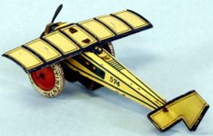 distler johann 574 tin toy airplane clockwork airplane monocoupe blue yellow
