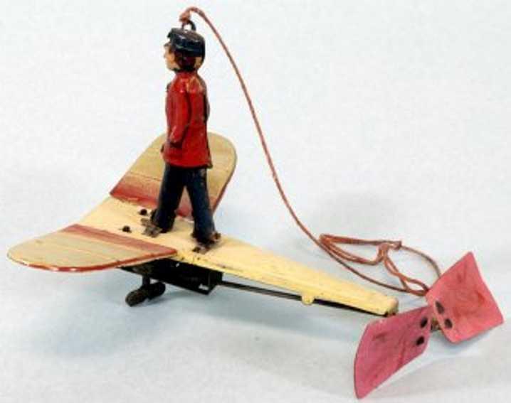 fischer georg blech spielzeug flugzeug flugzeug lithografiert mit uhrwerk und einer blechfigur die