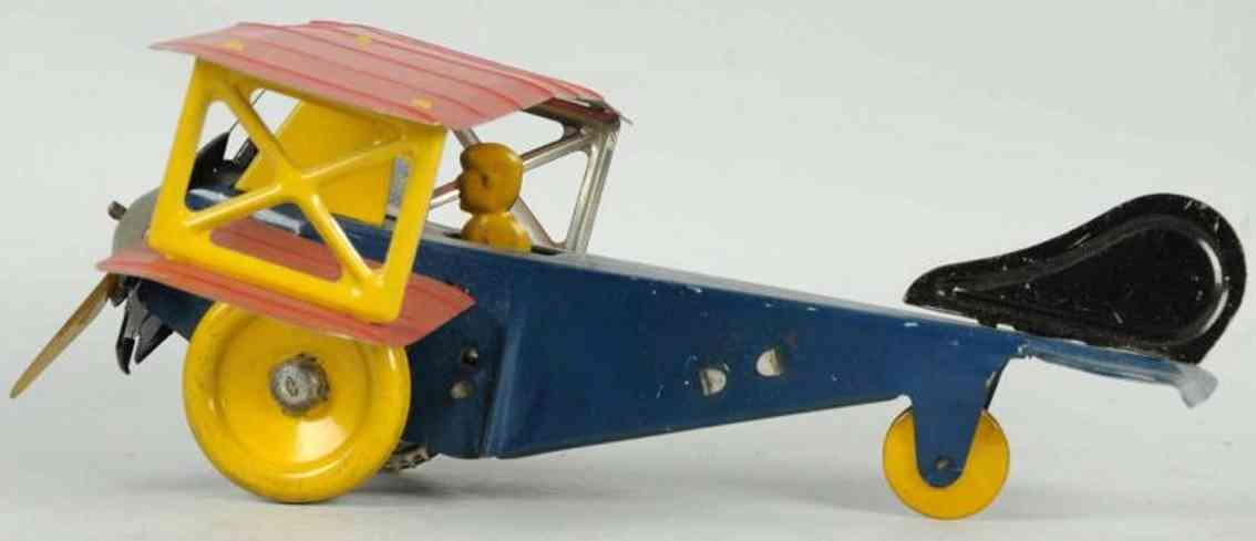 girard tin toy bi-wing airplane