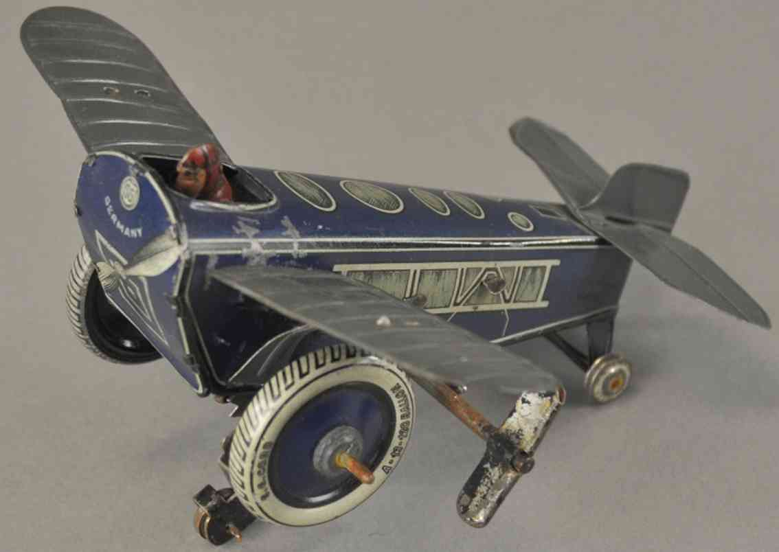 gunthermann 600 tin toy airplane rollover plane clockwork