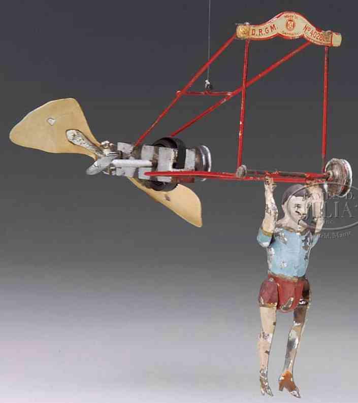 guenthermann blech spielzeug flugzeug akrobat mit fluggerät und uhrwerk, handbemalt, aufgezogen dr