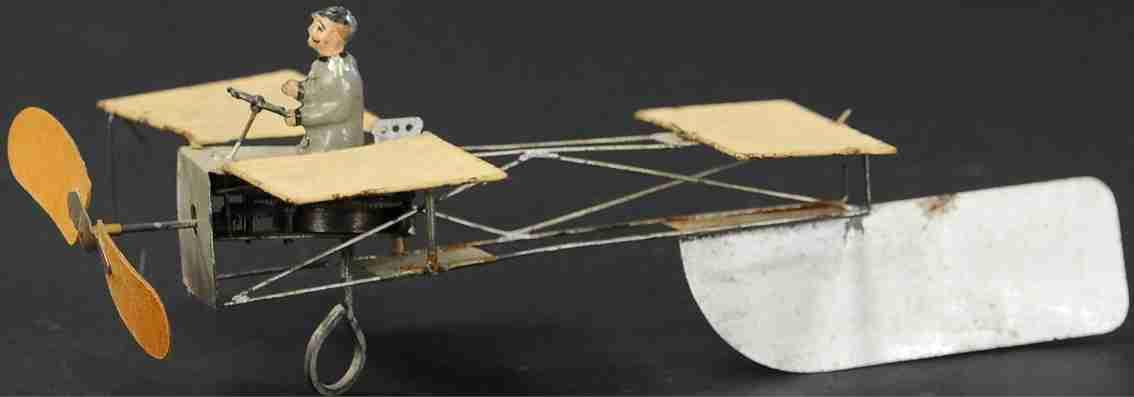 guenthermann blech spielzeug flugzeug mit uhrwerk und figur
