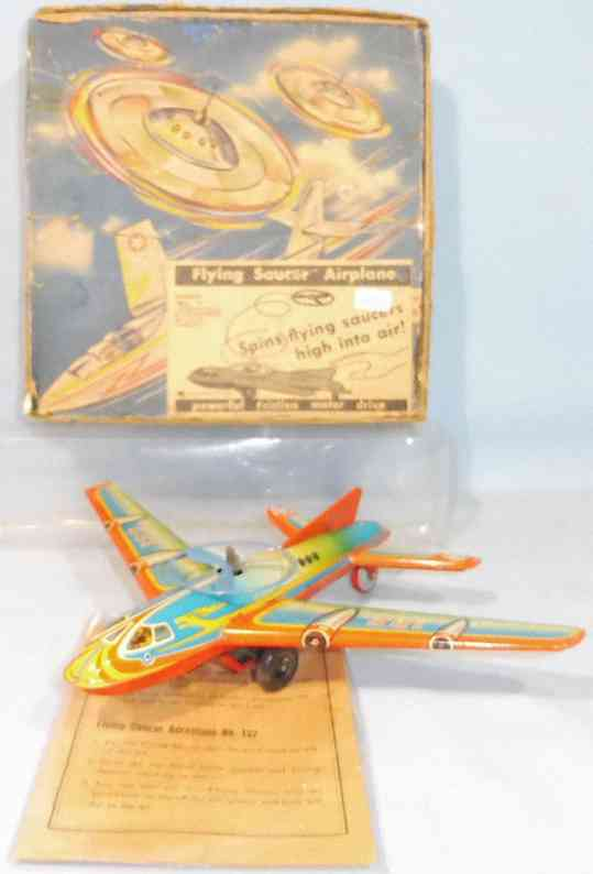 hoefler j h 132 tin toy airplane with two flying saucers