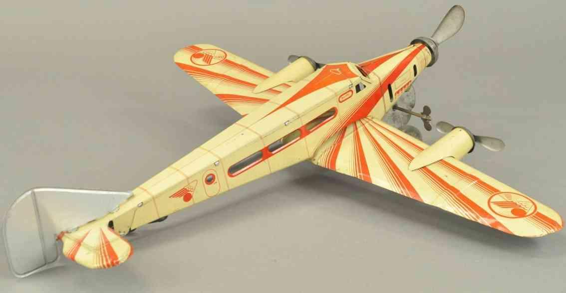 j.m.l. co tin toy airplane three prop jet