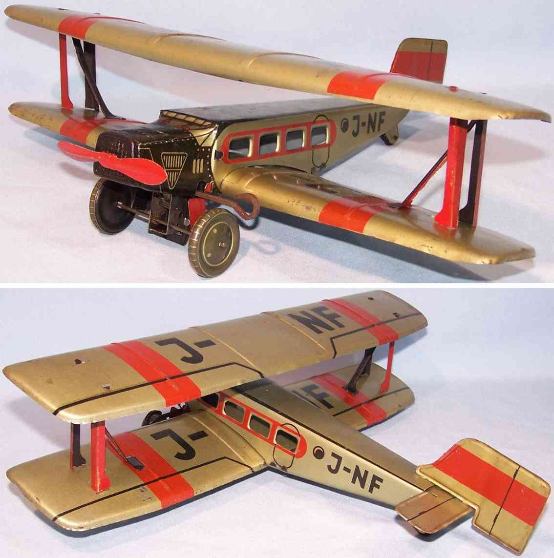 jnf neuhierl tin toy airplane biplane clockwork