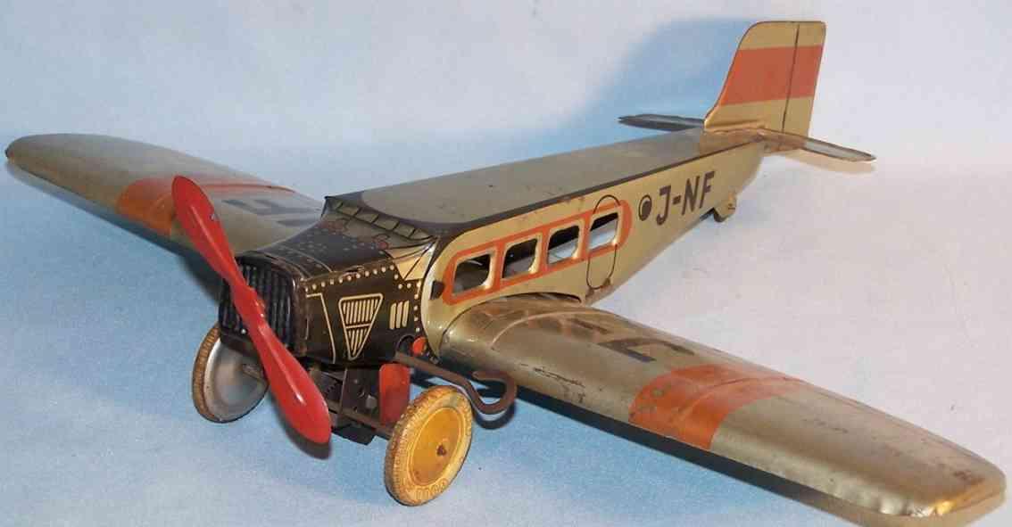 jnf neuhierl tin toy airplane monoplane aircraft clockwork