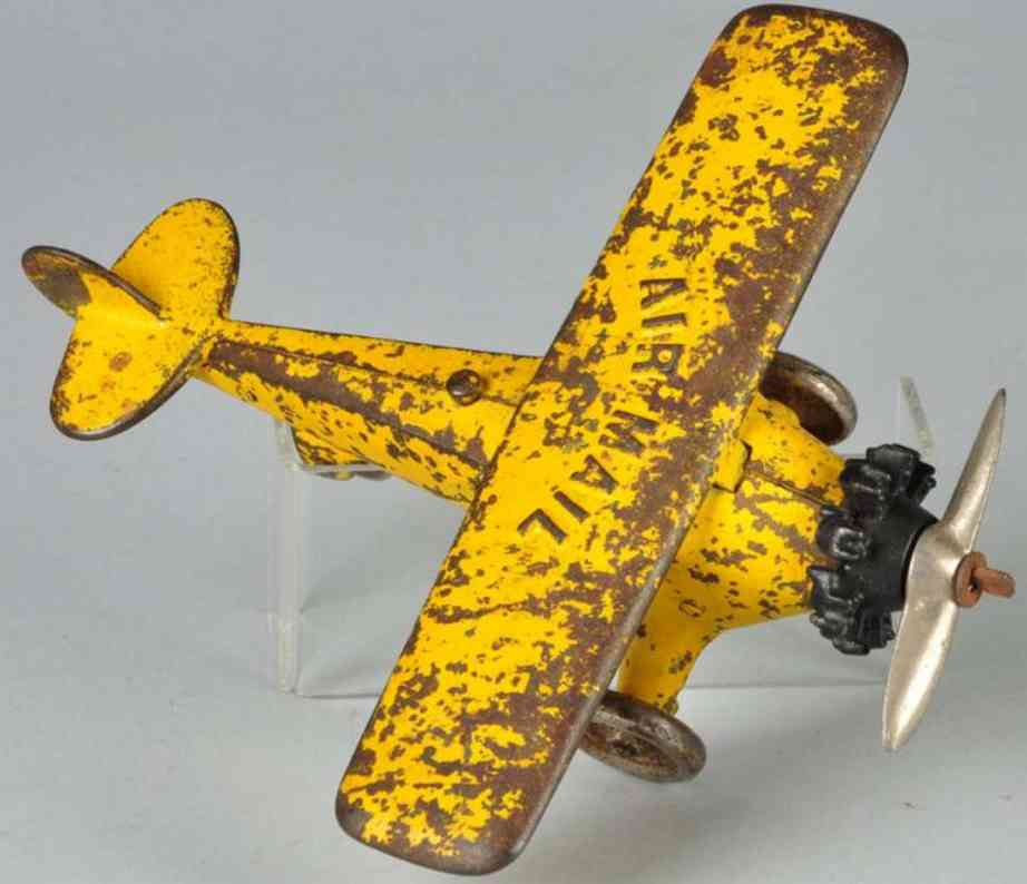 kenton hardware co cast iron toy air mail airplane yellow