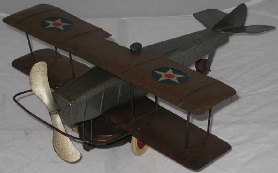 kingsbury toys tin biplane windup toy pilot