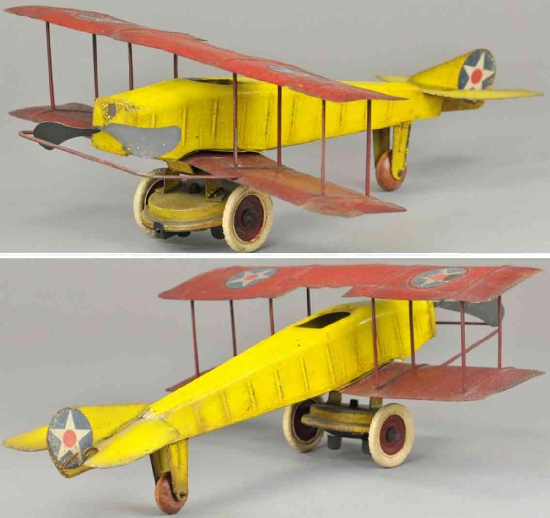 kingsbury toys tin toy stamped tin bi-airplane yellow red