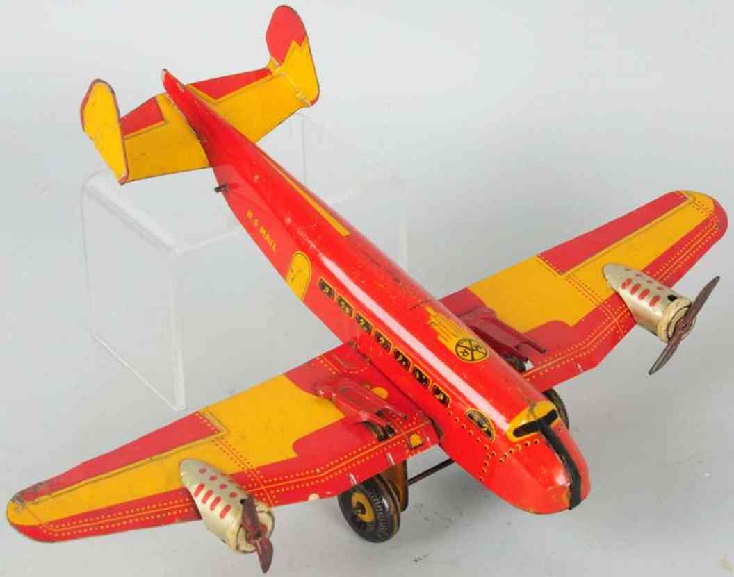 marx louis tin wind-up toy us mail plane red yellow guns