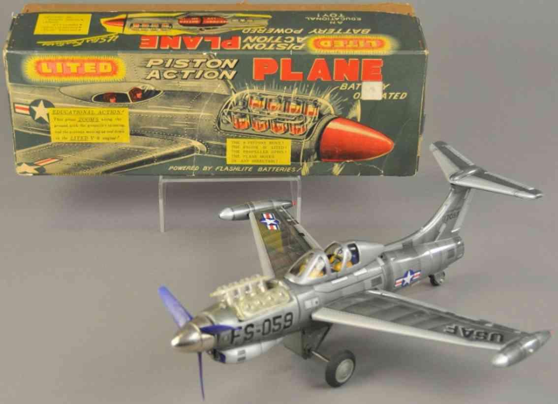 tn nomura toys fs-059 tin toy piston action airplane battery operated