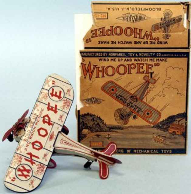 nonpareil toy & novelty co tin toy airplane whoopee plane, grey airplane with red & blue accents, tin wi