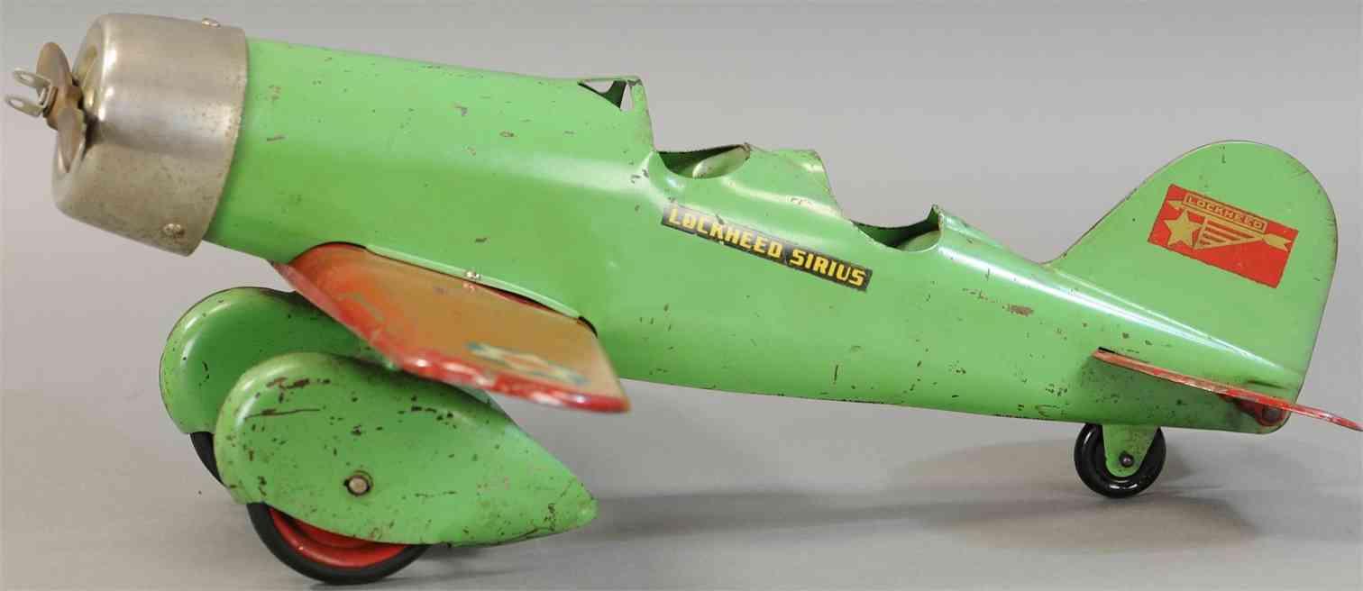 steelcraft stahlblech spielzeug lockheed sirius flugzeug zweisitzer gruen rot