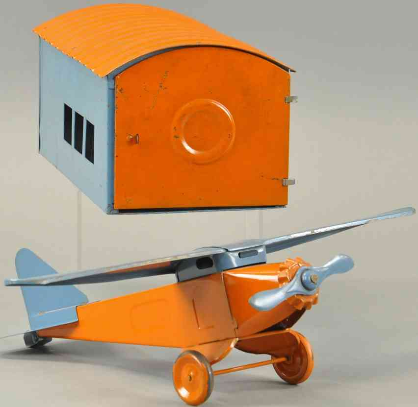 structo tin toy airplane with hangar