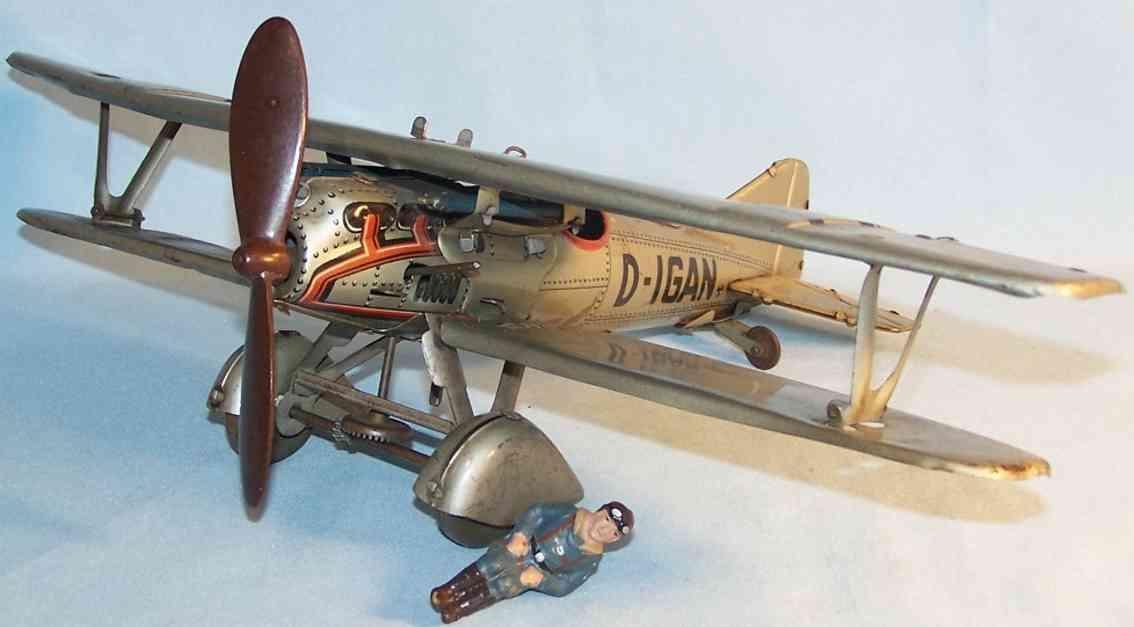 tippco 28d d-igan tin toy biplane with pilot