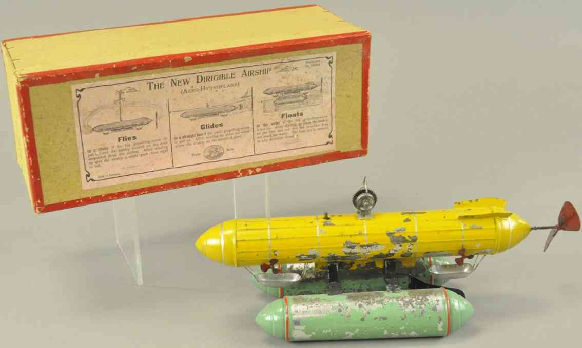 uebelacker tin toy zeppelin with pontoons yellow green