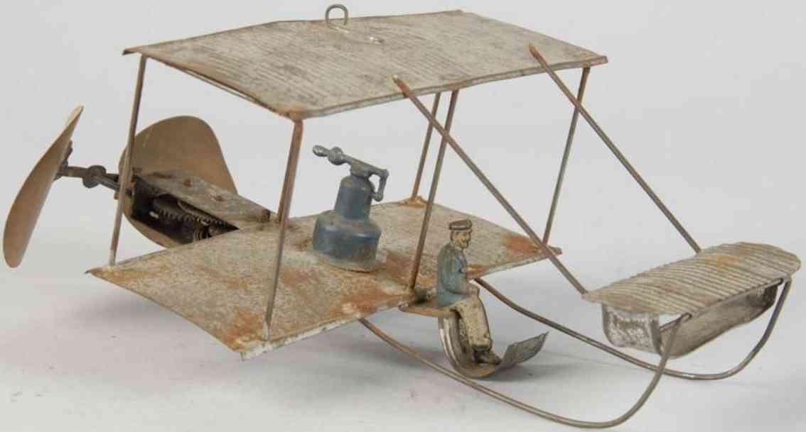tin bi-wing airplane German maker with pilot