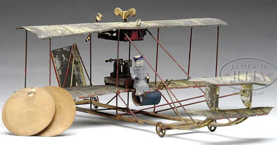 tin wind-up biplane with pilot