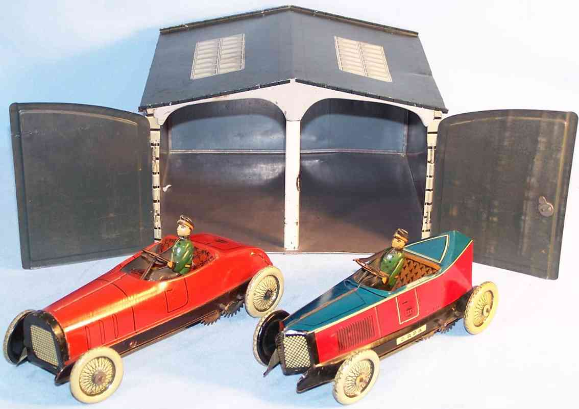 greppert & kelch 544/549/543 tin toy garage garage with two sports cars, lithographed in red, blue, beig
