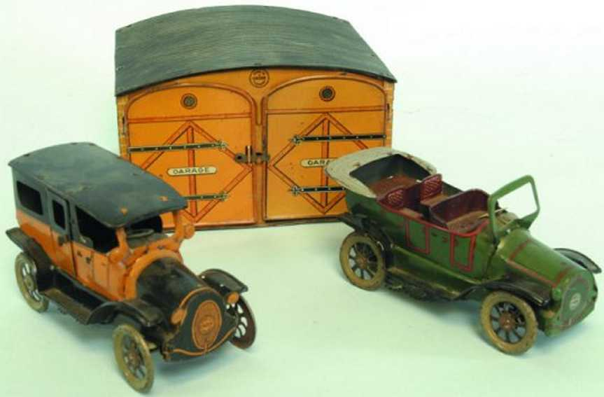 orobr tin toy garage garage with 2 vehicles one #127 green convertible & one hard