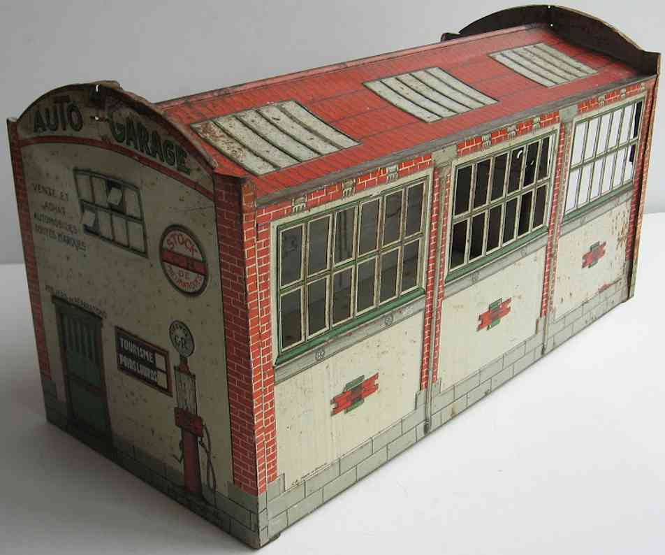 charles rossignol tin toy garage garage lithographed, one door is missing on the pictures