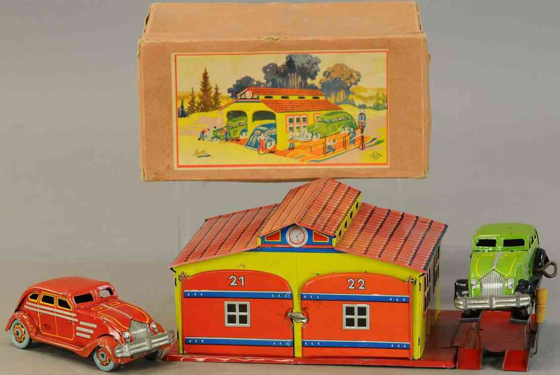 tin double garage with two airflow cars wind-up toys