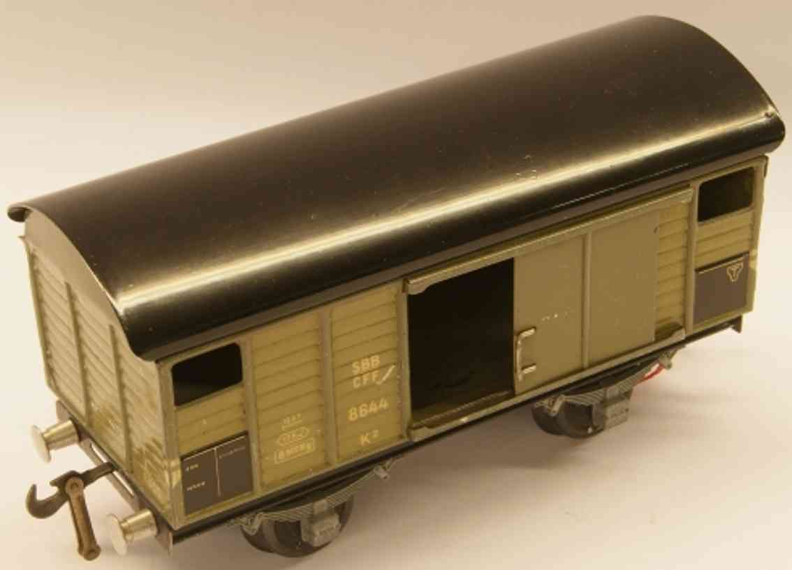buco bucherer 8644 (1947) railway toy box car; 2-axis; in olive-green and black, coupling 1