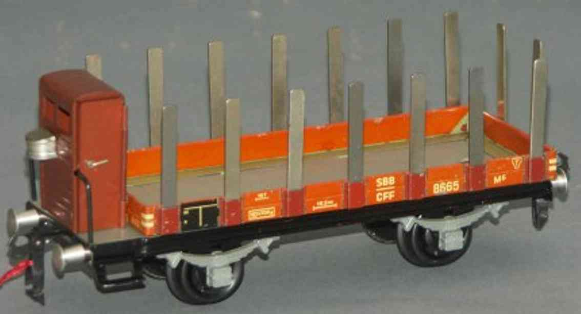 buco bucherer 8663 railway toy flat wagon with side stakes; 2-axis; in brown and gray with