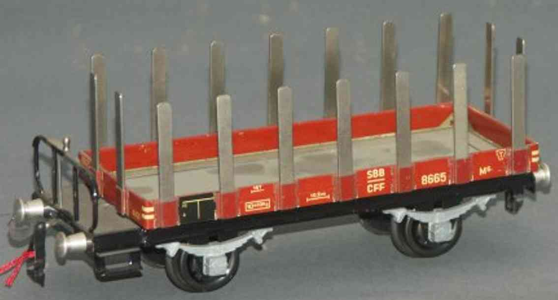 buco bucherer 8665 (1950) railway toy flat wagon with side stakes; 2-axis; in brown and gray, with