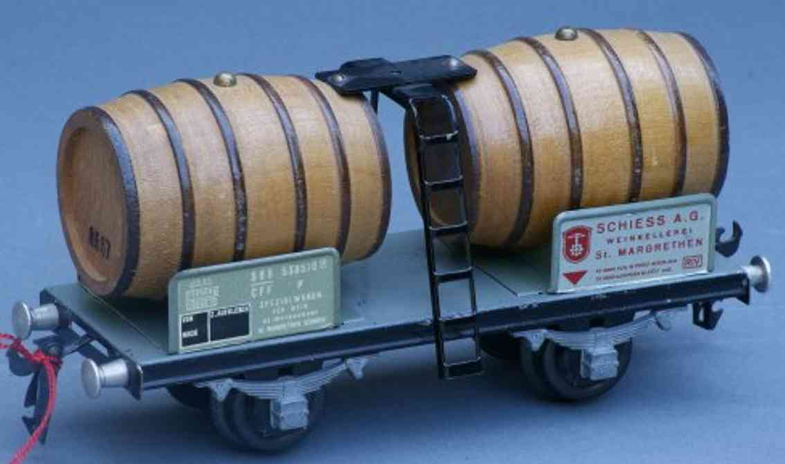buco bucherer 8667 railway toy barrel car; 2-axis, in light brown and gray, 2 signs, letter