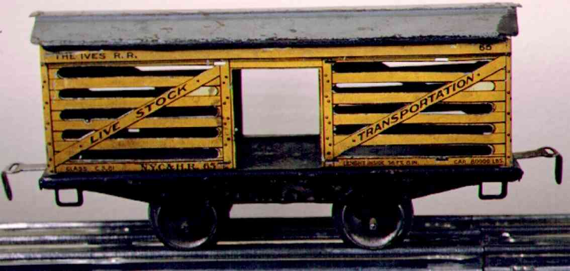ives 565 (1918) railway toy stock car; 2-axis; lithographed in yellow with gray roof
